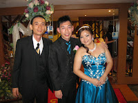 Jason Geh, the band manager flanked by newly weds Alvin and Casper
