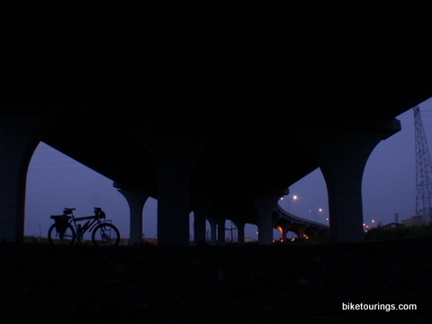 Picture of touring bike and bridge at dusk