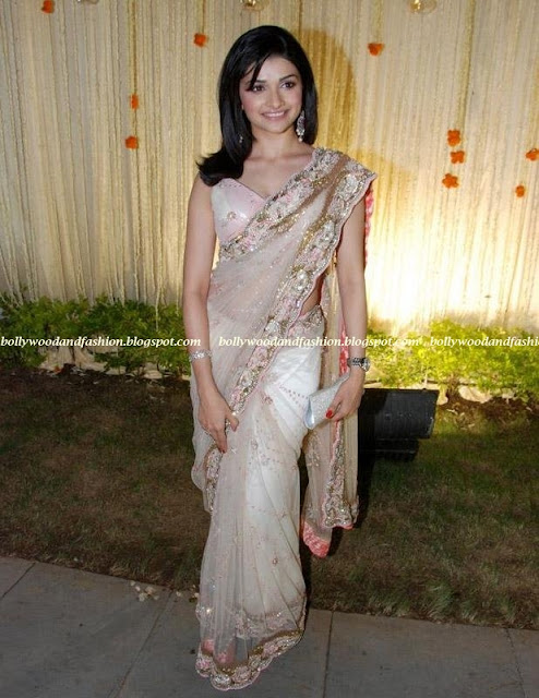 Parchi Desai - Sexy Sari with low neck blouse