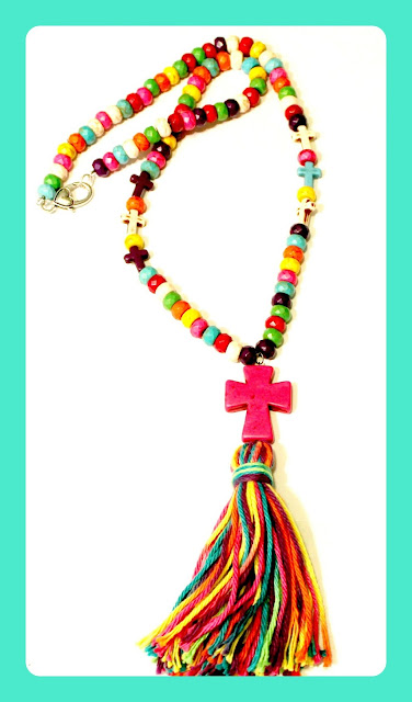 Bright cross necklace with tassel.