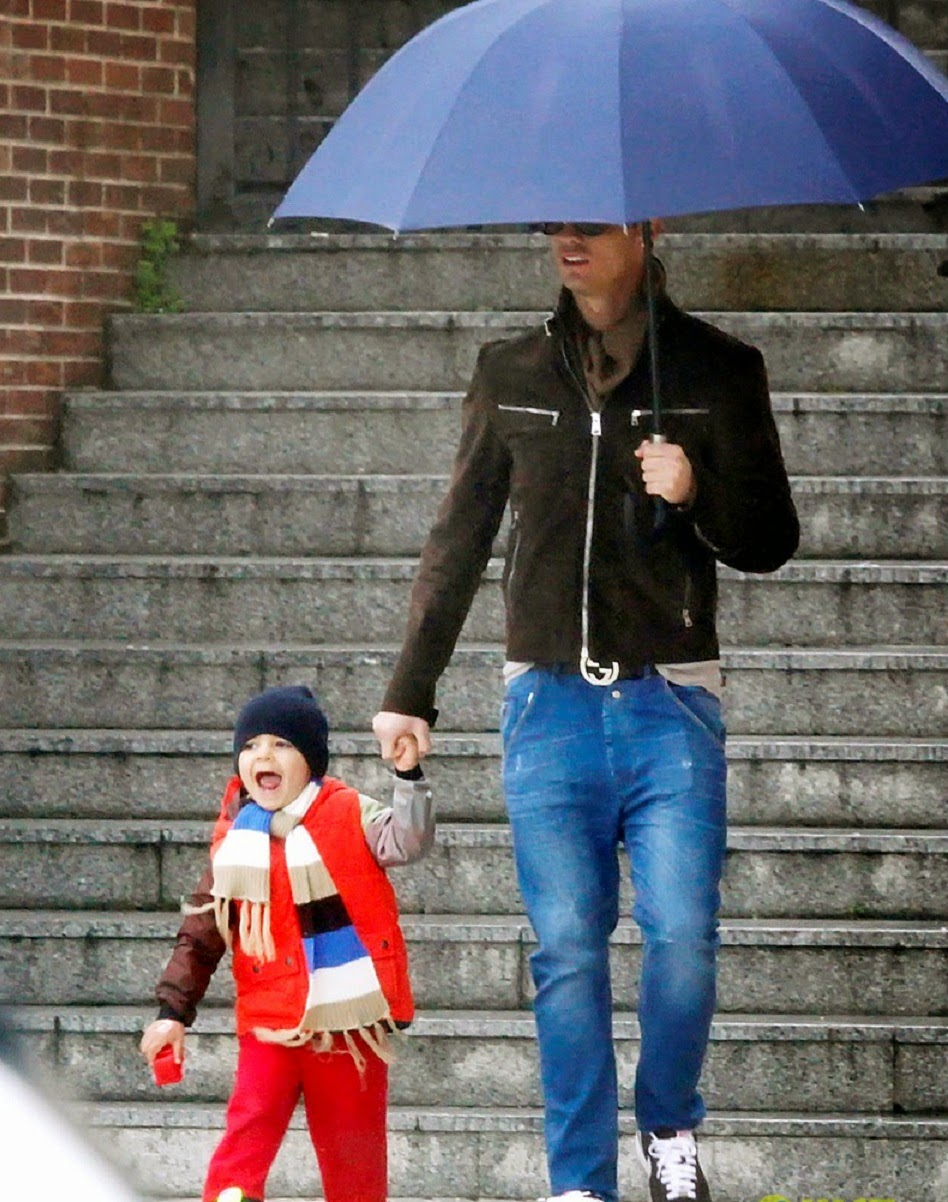 Cristiano Ronaldo JR Playing Under Umbrella