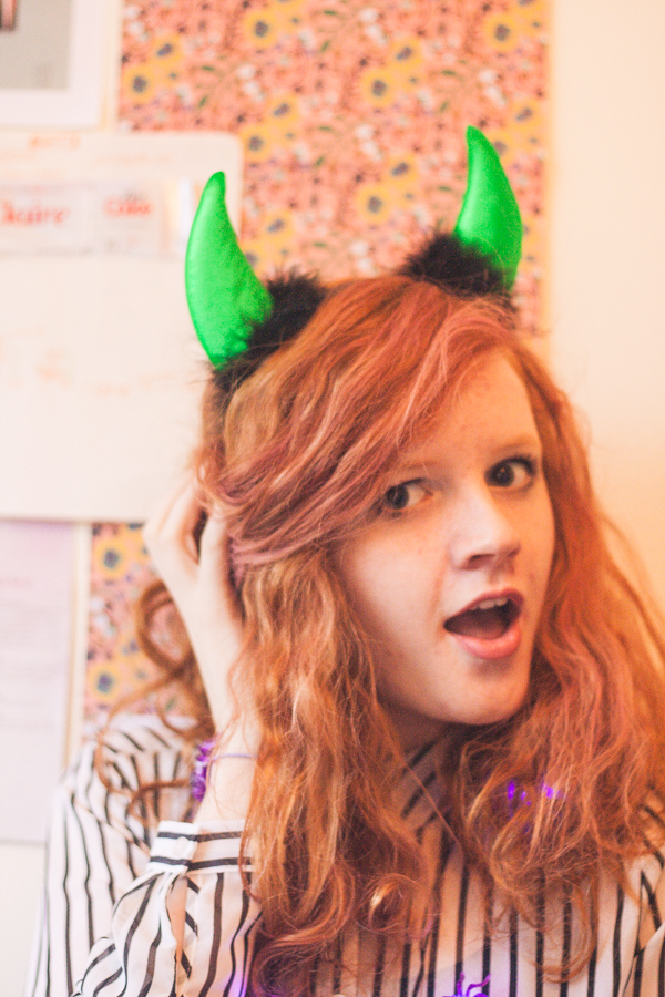 Green devil horns