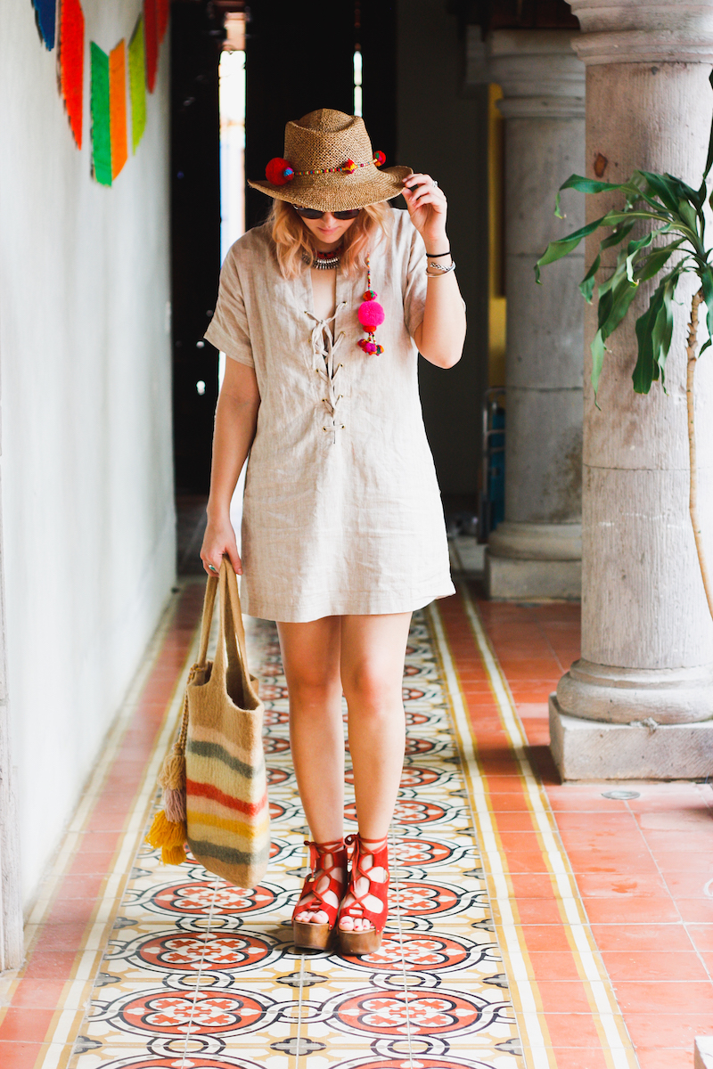 Sayulita, Mexico beach travel style in the reformation, kelsi dagger brooklyn, lace up platform wedges, and a pom pom garland straw fedora on bryn newman of Stone Fox Style.
