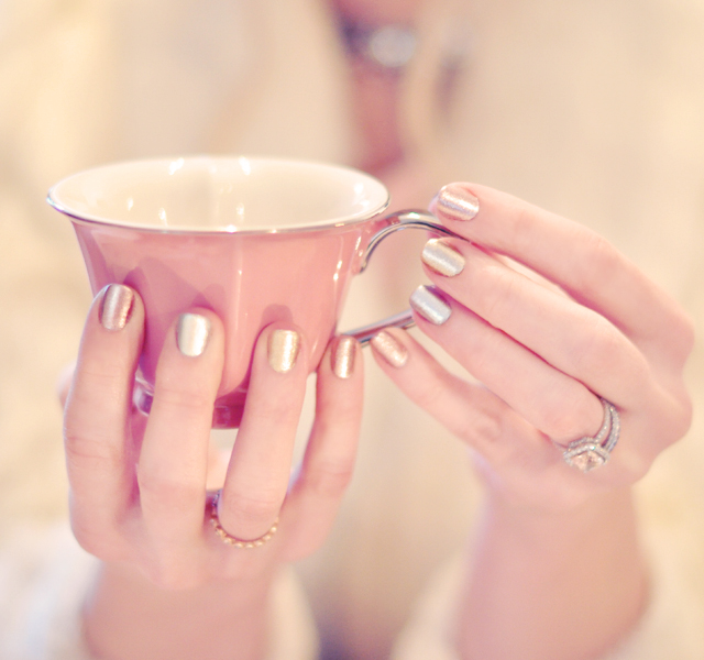 metallic nails, holding a pink heart teacup