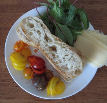 bread, heirloom cherry tomatoes, greens, cheese