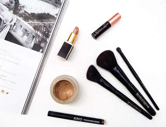 beauty makeup flat lay with makeup & brushes