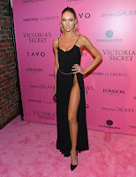 Candice Swanepoel shows off her body curves in a revealing black dress