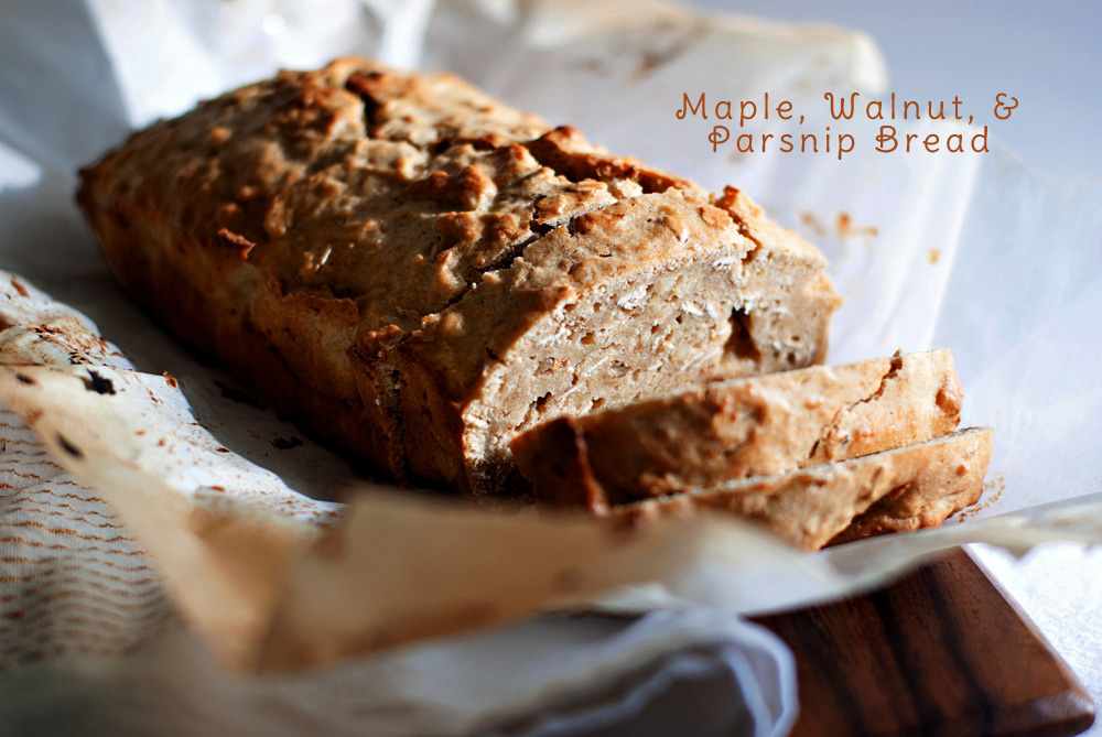 a photogrpah of maple, walnut, and parsnip bread, sliced