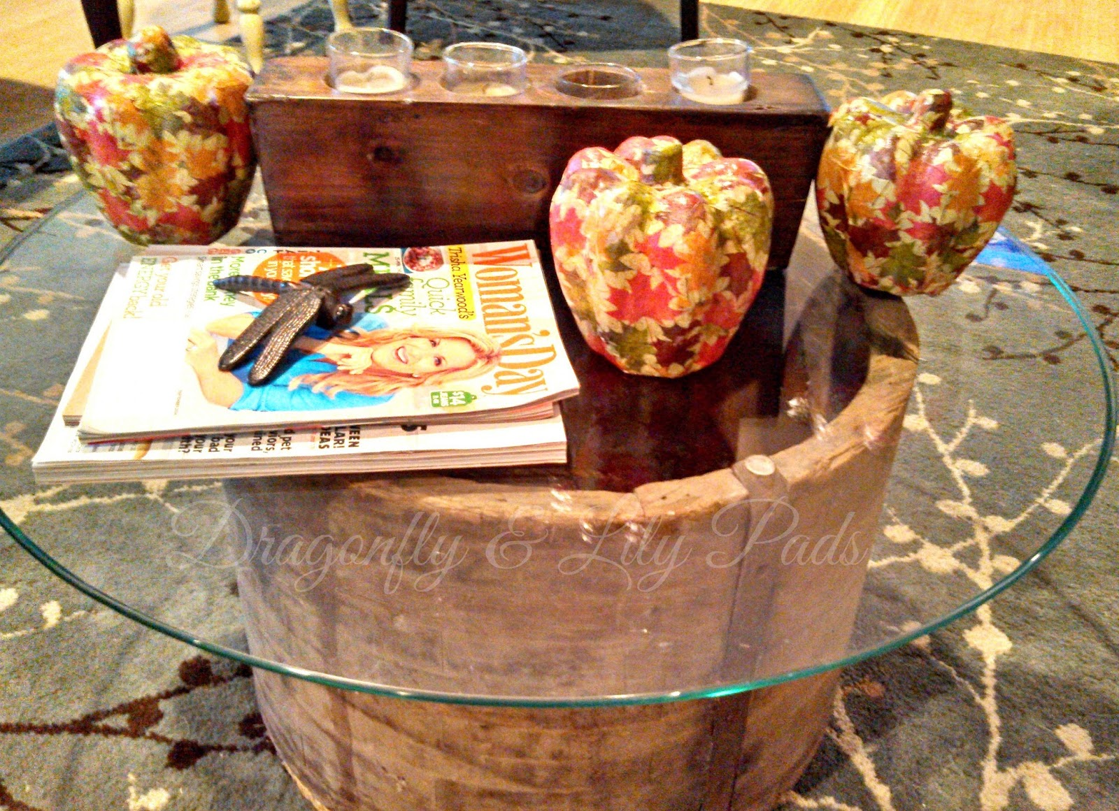 Pumpkins, Fall Leaves decorate pumpkins, Coffee table made from wood and rusty metal ship stack with glass top and rope bottom, dragonfly made of metal, Woman's Day Magazine