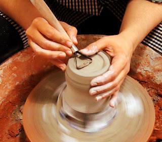 hands in pottery wheel