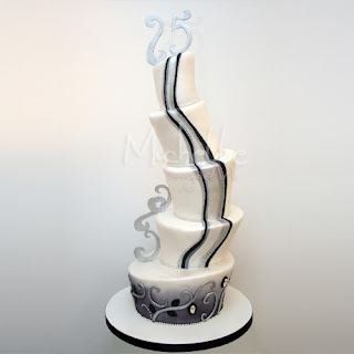 5 tier black and white topsy turvy wedding cake