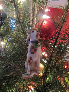 Patchwork caroling dog ornament