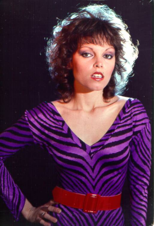 Pat Benatar 80s Fashion Brows were thick and arched.