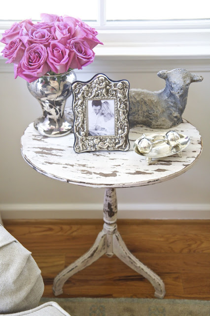 Side table with silver rattle, cherub frame, and lamb; Nursery in the Nest; Nora's Nest