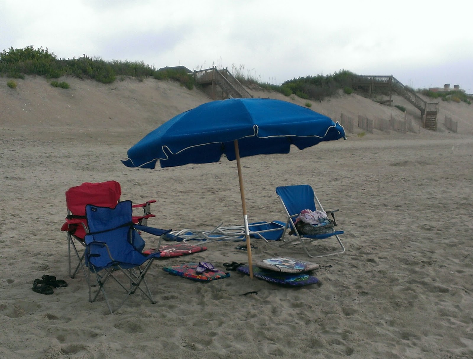 Chairs and an umbrella at the beach