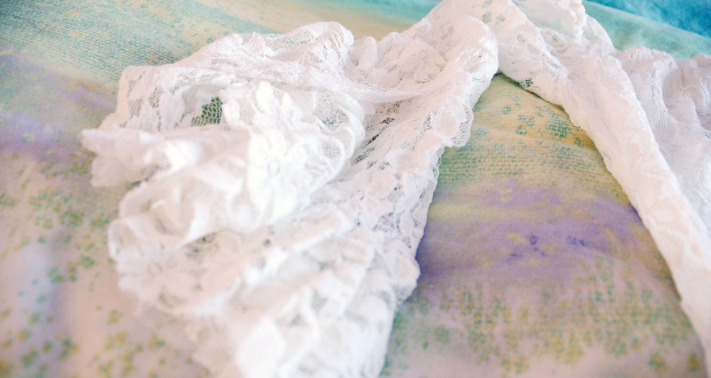 Close-up of the bell sleeves on the white lace summer bohemian dress from Milanoo.