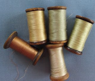 http://atthesignofthegoldenscissors.com/collections/vintage-trim/products/vintage-flat-silk-spools