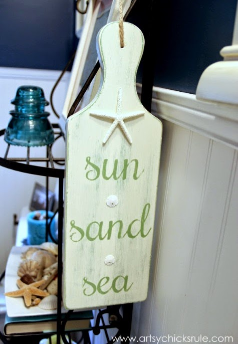 cutting board painted with beach saying