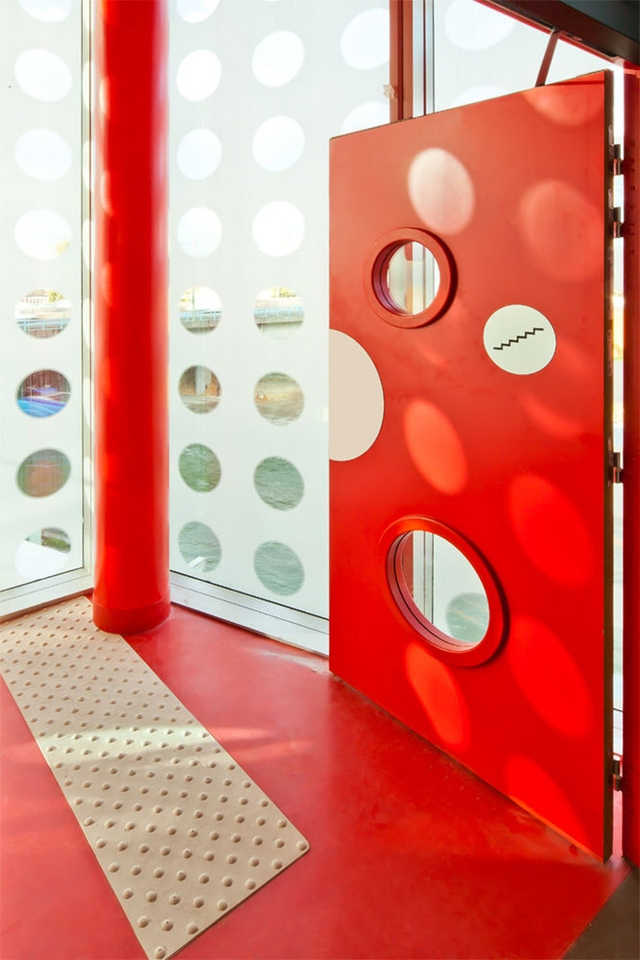 Close up photo of red entrance door