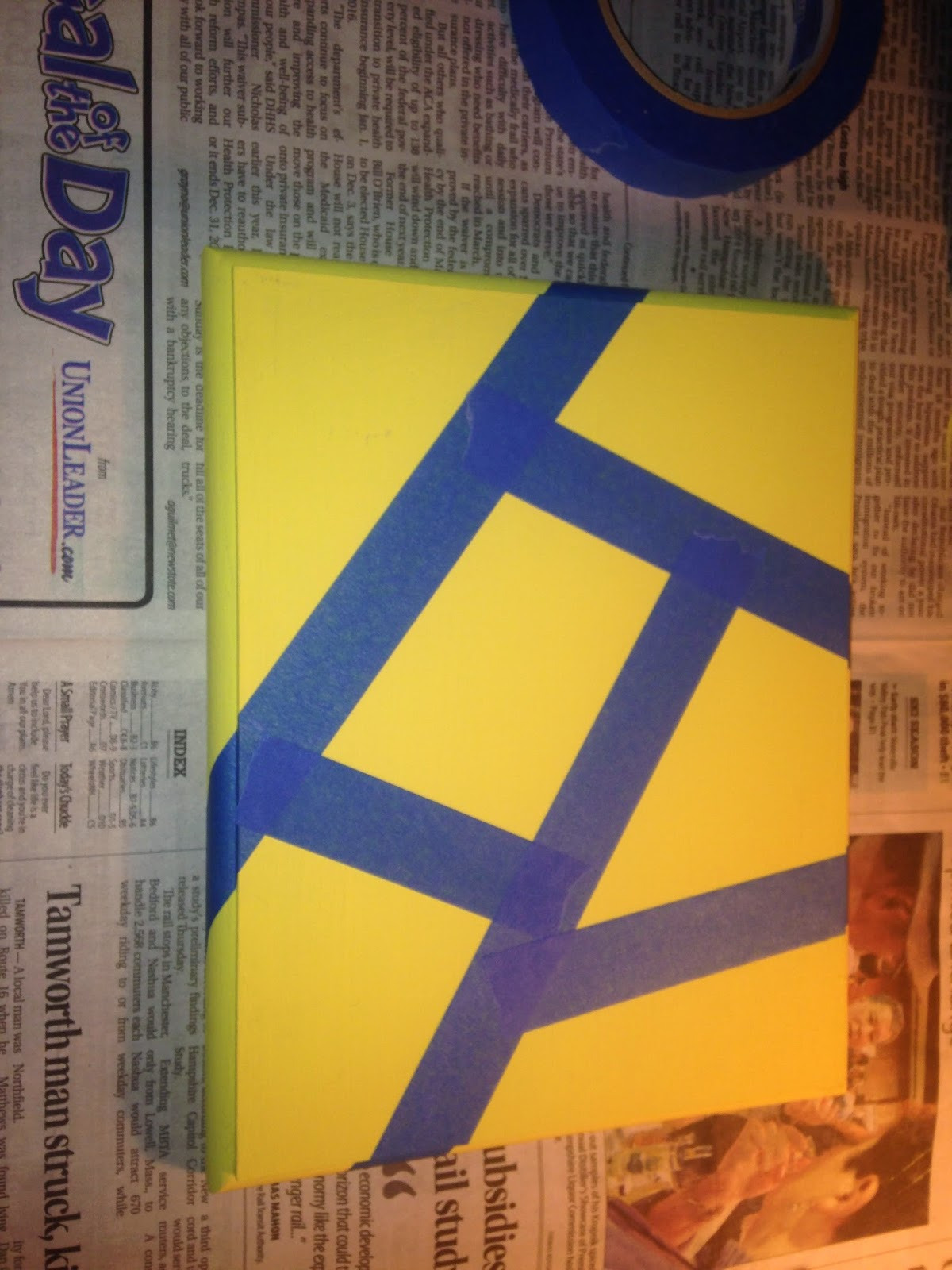 yellow block with blue painter's tape