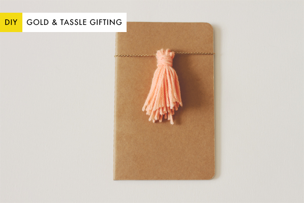 Wrap your gifts in an unconventional style with a gold chain and yarn tassel!