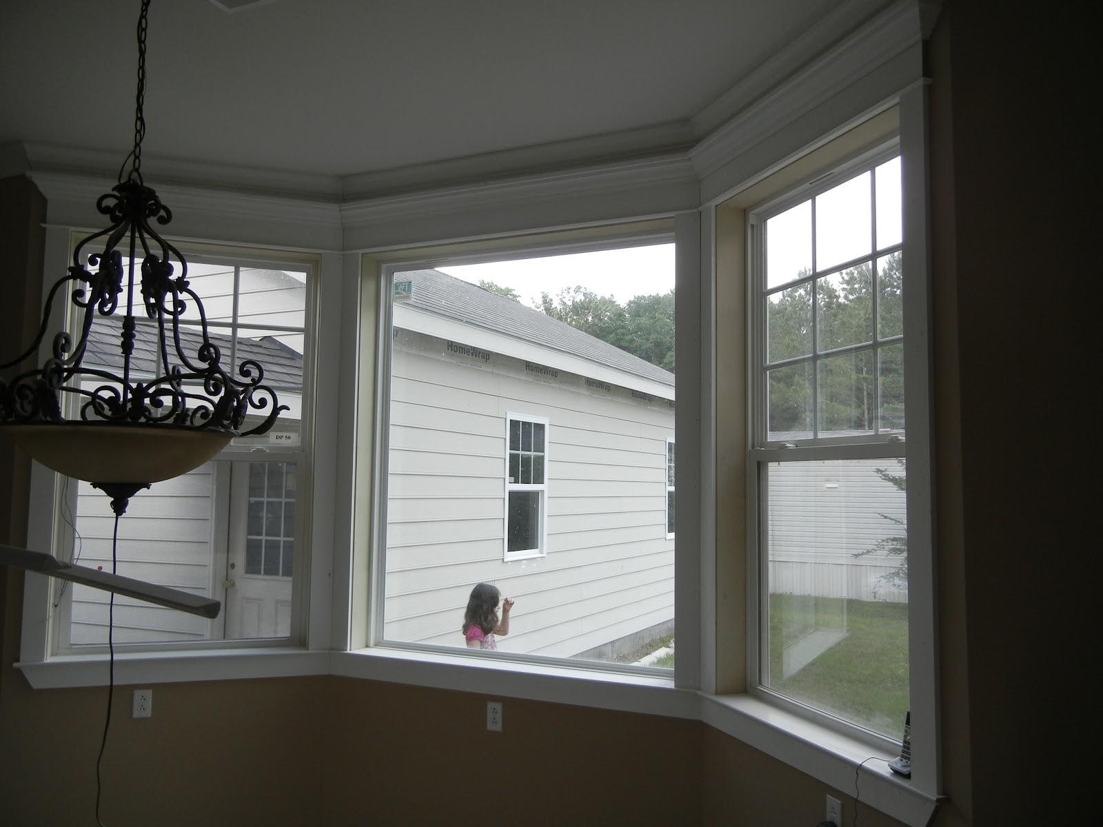 Double oak plantation breakfast nook bay window trimmed for Bay window breakfast nook