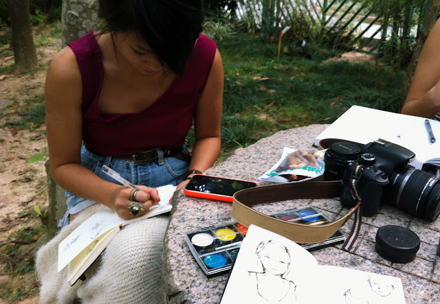 hipster sketching at park dslr