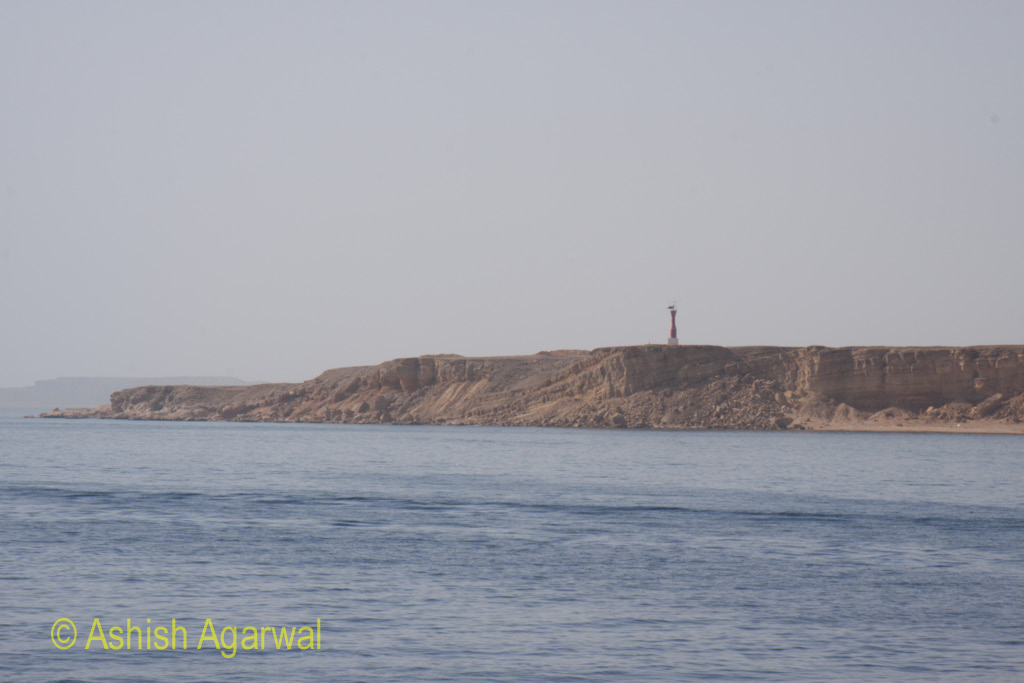 Rocky cliff near the shore of the Red Sea in Sharm el Sheikh in Egypt