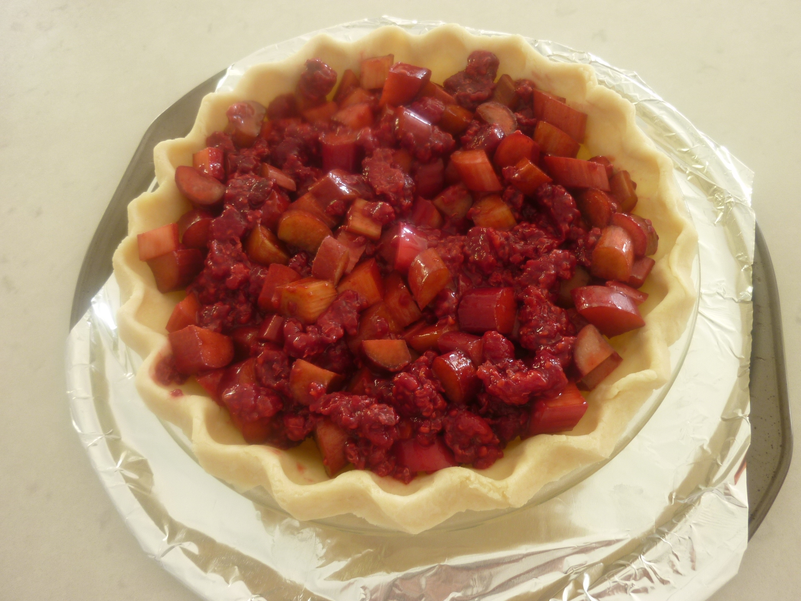 Mix the rhubarb and raspberries and pour into unbaked pie shell.