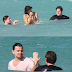 Leonardo DiCaprio and Jonah Hill swimming with a topless woman