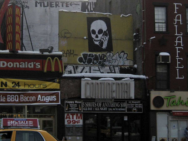 Cellphone Skull - Above the Continental's '5 Shots of Anything $10' sign; on 3rd Ave. off St. Marks Place.