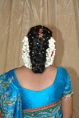 Long hair made as bun and decorated with buttons.