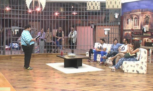 Bigg Boss 7 contestants listening to the written order of Bigg Boss