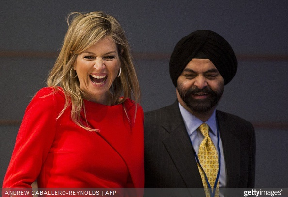 Queen Maxima of the Netherlands laughs next to Ajay Banga, CEO of Mastercard, during a meeting for 'Universal Financial Access 2020' at the IMF/WB Spring Meetings in Washington, DC on