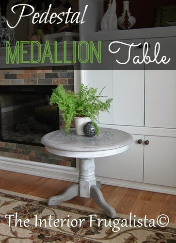 Round pedestal medallion table after a masculine makeover