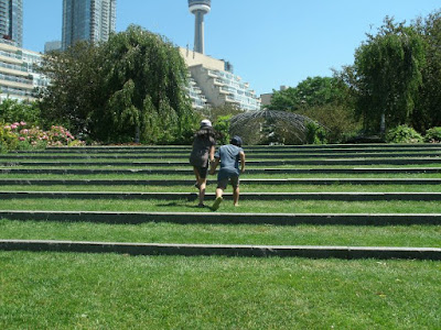 Toronto Music Garden Gigue section with kids running up stairs by garden muses: a Toronto gardening blog