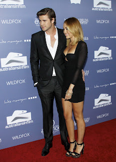 Miley Cyrus on the red AIF red carpet with her fiance