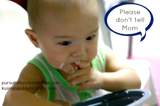 Funny Baby Photo eating rice from the rice cooker