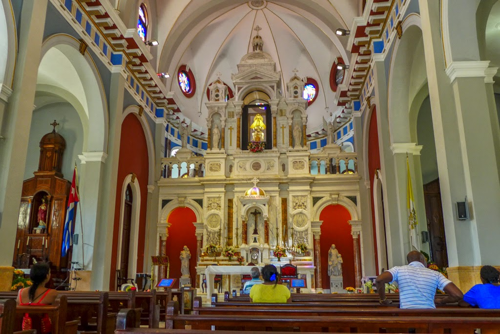 El Cobre the altar and colorful interior of the basilica