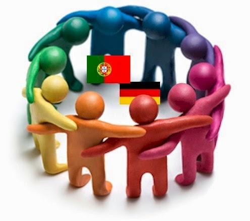 vários bonecos de braços entrelaçados, formando uma roda, com as bandeiras de portugal e da alemanha no centro