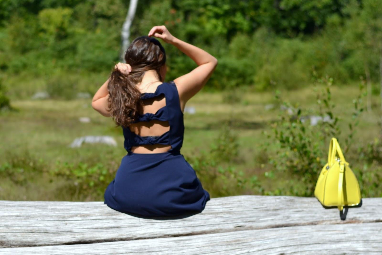 blue dress, backless, yellow bag