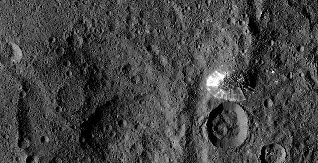 NASA's Dawn spacecraft spotted this tall, conical mountain on Ceres from a distance of 915 miles (1,470 kilometers). The mountain, located in the southern hemisphere, stands 4 miles (6 kilometers) high. Image credit: NASA/JPL-Caltech/UCLA/MPS/DLR/IDA