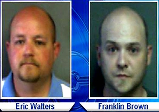 Police officers Eric Walters and Franklin Brown