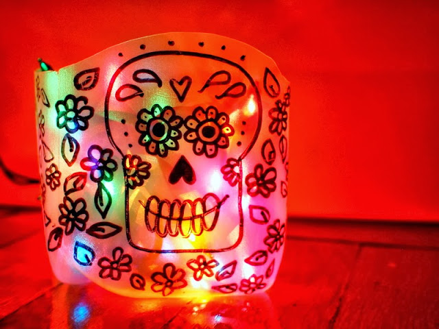 Diy sugar skull day of the dead milk jug luminaries for Christmas crafts with milk cartons