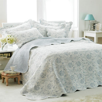 bedroom showing light blue quilted bedspread, opulent