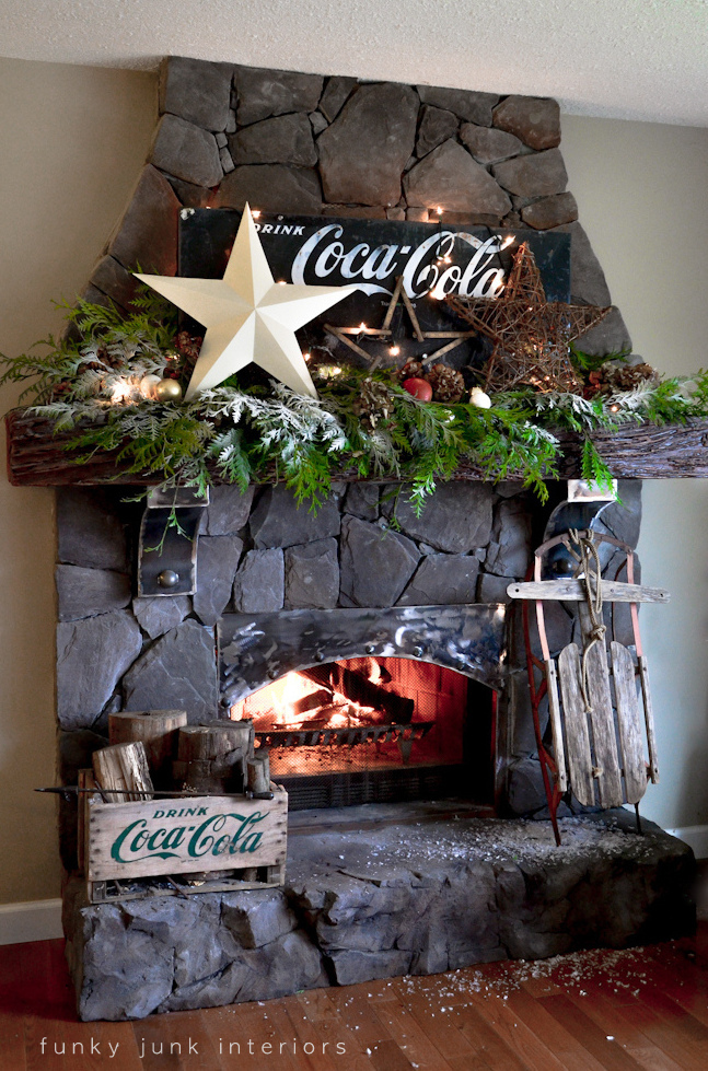 Coca Cola inspired Christmas fireplace mantel decorating with stars - via : http://www.funkyjunkinteriors.net/