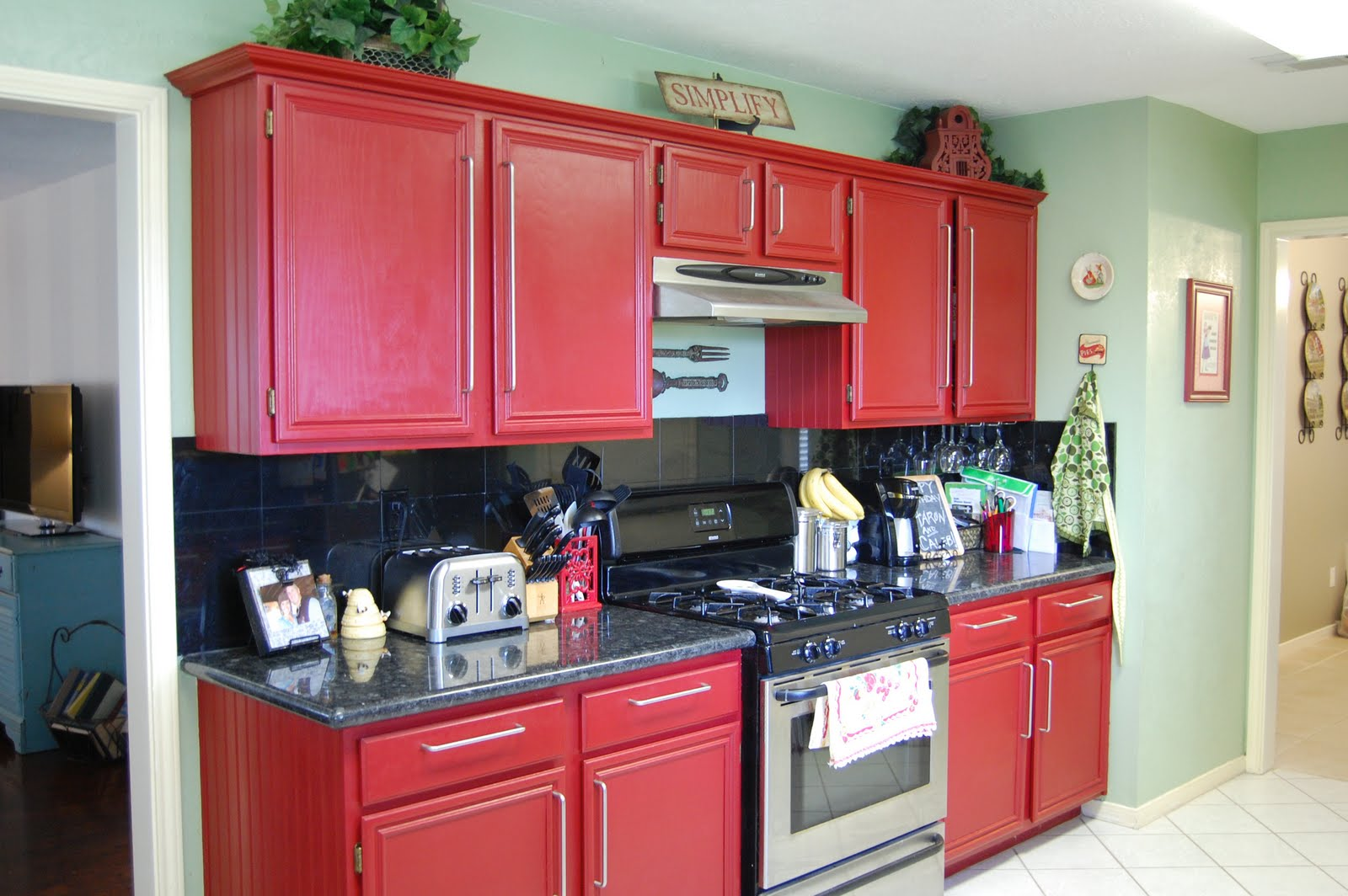 Red Kitchen Walls with Oak Cabinets