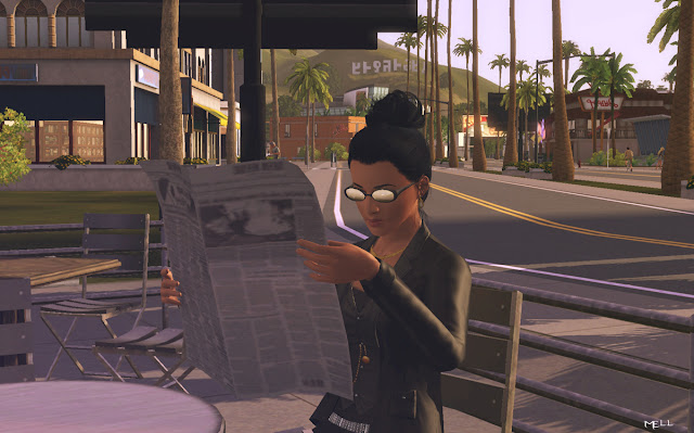 A sim reading a newspaper