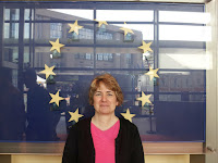Pic of Karen of Anglicity in front of stars of European Union insignia