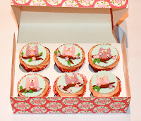 Box of apple and cinnamon cupcakes with cute owl toppers